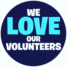 """button which says  """"We love our volunteers"""""""